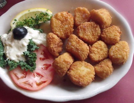 Lightly coated fresh Sea Scallops, fried and served with Tartar Sauce at Mama Leone's.