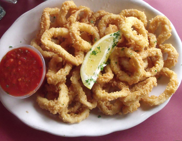 Fried Calamari appetizer at Mama Leones Calamari rings lightly battered and fried golden brown served with marinara sauce.